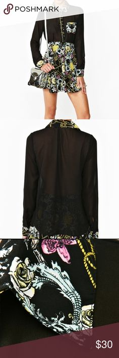 Nasty Gal Roma Pocket Blouse Nasty Gal Black Roma Pocket Blouse Sheer black chiffon blouse featuring a chest pocket and multicolor baroque print. Button closures, loose fit. Looks amazing with peplum pants and sky-high pumps! By Nasty Gal. M Nasty Gal Tops Blouses