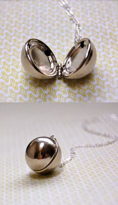 Silver Orb Locket                                                     ~~AAAAHHHHHHH!!!!!!!!!! I  WANT  THIS!!!!!!!!