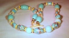 SALE Venetian vintage glass hand painted beads,aquamarine beads,crystals and gold plated spacers combined elegance makes this a stunning unique necklace with matching earrings. The necklace is 21 inches long.. <br>A matching bracelet can be purchased separately<br>https://www.etsy.com/listing/178547569/...