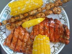 Chef Shawn's BBQ Grilled Asian Salmon and garlic butter basted lemon shrimp.