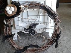 black and burlap bird wreath made of fan covers