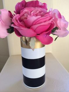 Measures 7.5 tall. Vase is hand painted white with a single gold vinyl stripe and 2 black vinyl stripes. Vase is sealed for durability. The vinyl