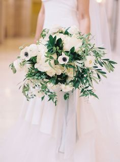 ANEMONE & RANUNCULUS BOUQUET: A lovely blend of greenery and flowers, this white bouquet is a crisp highlight to a neutral color scheme.  Via Amy Burke Designs and Caroline Tran Photography