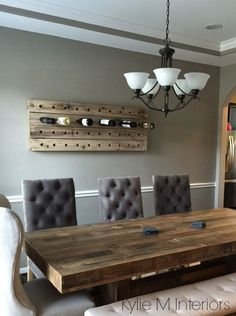 benjamin moore rockport gray is a nice paint color for any room. Shown here with rustic dining table and wine bottle holder and crown moulding in dining room