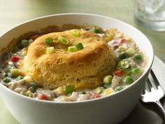 Biscuit-Topped Turkey Pot Pies - A tender biscuit bakes over a creamy, cheesy filling in a just-for-two comfort food classic.