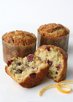 """Cranberry-Orange Muffins - made this morning - only had 1/2 whole wheat flour and then the timer didn't go off so in the words of my toddler """"they are a little dry"""" ... But I think with regular flour and normal baking time they would be excellent - I still like them a lot with a little butter ;)"""