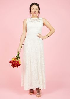 <p>From the moment your eyes open in the morning until the last second spent in this white lace gown, your day is a total dream! Charming scalloped accents detail the illusion neckline of this boho-inspired dress, bringing a true brilliance to your big day.</p>
