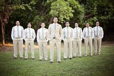 Suspenders on the groomsmen! Love the nontraditional soft look of the boys