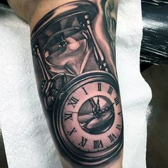 Clock And Hourglass Realistic Mens Upper Arm Tattoos Time Piece Tattoo, Time Tattoos, Hand Tattoos, Clock Tattoos, Hour Glass Tattoo Design, Clock Tattoo Design, Pocket Watch Tattoos, Upper Arm Tattoos For Guys, Mens Upper Arm Tattoo