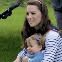 The Duchess of Cambridge and Princess Charlotte at Houghton Hall International Horse Trials. Lottie is getting so so big, and that blue bow is going to kill me