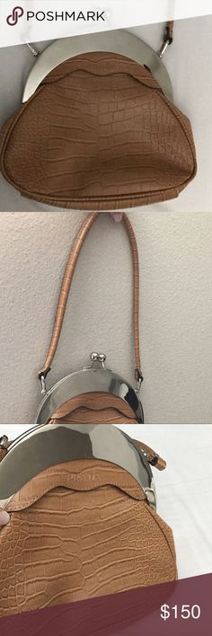 INSPIRED vintage Prada bag Inspired vintage Prada bag that is super cute to wear out!! Bag is in great condition! Inside of bag has some minor fade marks nothing noticeable ❤️ Bags