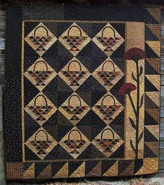 Gathering Baskets Quilt Pattern. I like the border and applique side.