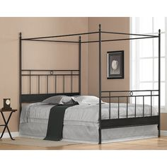 Black Metal Queen-size Canopy Bed. The Frame Has Horizontal and Vertical Bars...
