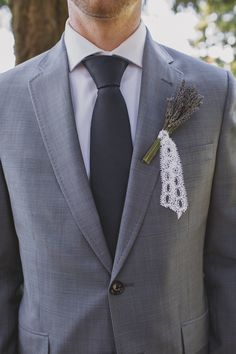 grey groomsman with lavender boutonniere