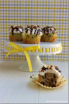 Chunky Monkey Cupcakes: Banana-flavored cupcakes with vanilla buttercream frosting, chocolate ganache, banana chips, and sugared walnuts.  Tastes just like the ice cream flavor!  {from 2 Sisters 2 Cities}