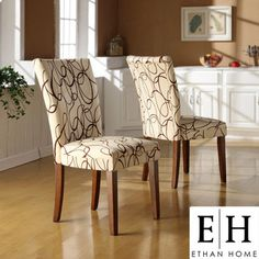 @Overstock - Give your space a fun update with these upholstered accent chairs. This set includes two chairs with rubberwood frames and linen upholstery. The brown swirls on a tan background make a bold statement; it's an ideal addition to any decor.http://www.overstock.com/Home-Garden/ETHAN-HOME-Chocolate-Swirl-Print-Accent-Chairs-Set-of-2/4401057/product.html?CID=214117 $134.99