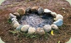 garden fire pit- my son did something like this on the beach at the lake - we found some firewood to burn and cooked steaks on sticks over it :)