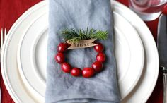 Make Mini Cranberry Wreath Place Cards For Your Holiday Party via Brit + Co.