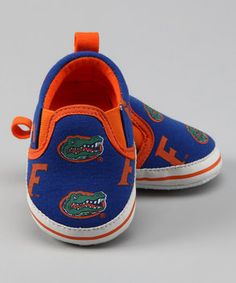 College Colors - baby Florida Gator shoes..Johnathon thinks this are a must. I'm thinking Red and Black though ;)