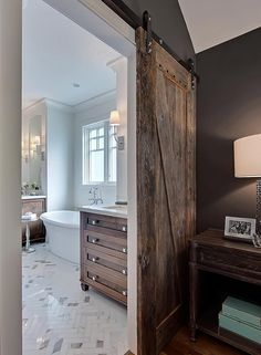 Barn doors today are becoming part of interior decoration in many houses because they are stylish. When building a barn door on your own, barn door hardware kit Wood Barn Door, Barn Door Hardware, Veranda Interiors, White Master Bathroom, Master Bedroom, Brick Design, Home Inc, Interior Barn Doors, Modern Bathroom Design