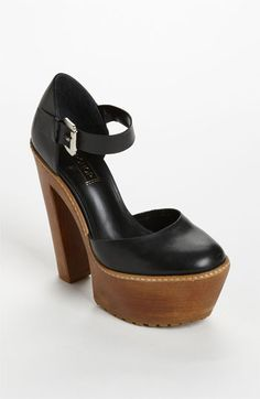 I want these. Similar to the Chloe Sevigny x Opening Ceremony heels seen here http://chicityfashion.com/black-and-gold-style/