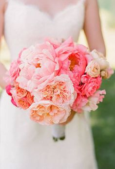 Beautiful arrangement of pink-and-coral peonies and garden roses | 44 Fresh Peony Wedding Bouquet Ideas : Brides.com