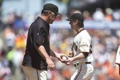 SAN FRANCISCO, CA - JULY 30: Tim Lincecum #55 of the San Francisco Giants is relieved by manager Bruce Bochy #15 during the fourth inning against the Pittsburgh Pirates at AT&T Park on July 30, 2014 in San Francisco, California. (Photo by Jason O. Watson/Getty Images)