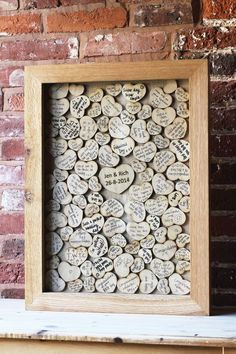 Cute idea for a guest book! You could scatter the hearts on the tables and ask everyone to sign them and drop them in a box!