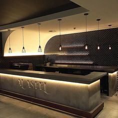 Concrete bar poured in situ, finished off with a floating steel and timber foot…