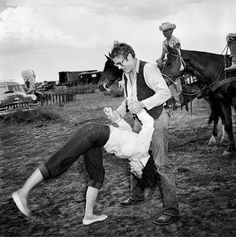 """Elizabeth Taylor and James Dean having fun on the set of one of my favorite movies, """"Giant"""""""