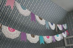 I love this cute paper doily garland idea.   http://threeyearsofdeath.blogspot.co.nz/2011/07/1-doily-garland-giveaway.html#