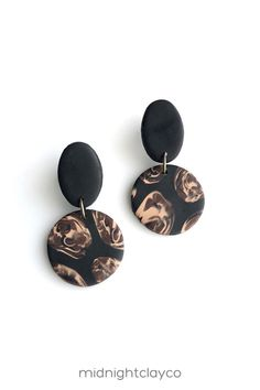 Black, biege, and brown marble polymer clay earrings. Circle shaped dangle earrings. Unique boho style earrings make the perfect accessory for a summer or fall work outfit. Give as a unique birthday gift for female cousin, aunt, or niece. Makes a great fall birthday gift! Shop these trendy handmade earrings for women in my etsy shop! Brown Earrings, Circle Earrings, Women's Earrings, Fall Birthday, Fall Outfits For Work, Unique Birthday Gifts, Circle Shape, Polymer Clay Earrings, Earrings Handmade