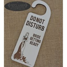 "White ""Bride Getting ready"" door sign"