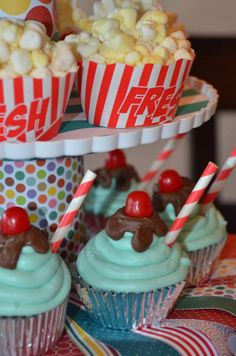 Popcorn and ice cream sundae cupcakes at a circus birthday party! See more party planning ideas at CatchMyParty.com!