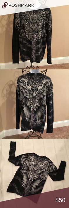 AFFLICTION TEE  NWRT AFFLICTION GRAPHIC LONG-SLEEVE TEE WITH FACTORY DISTRESSING ON THE COLLAR, SLEEVE ENDS AND BOTTOM OF SHIRT. % COTTON AND MADE IN THE USA. SHADES OF BLACK & GREYS WITH SILVER AND WHITE GRAPHICS. Affliction Shirts Tees - Short Sleeve