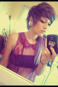 I would love to have my ears stretched and hair like hers
