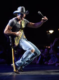 Tim McGraw performs onstage during his Shotgun Rider tour at Nikon at Jones Beach Theater on June 11, 2015 in Wantagh, New York. (Photo by: Kevin Mazur/ Getty)
