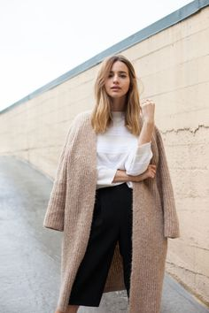 camel cardi coat, long sleeves white top, black culottes