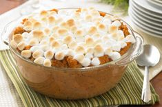 Whipped Sweet Potato Bake.......    Found this to be a tasty lower fat & calorie version of the traditional Sweet Potato Casserole.  The marshmellows are the added sweetness rather than sugar.  You can also boil & mash the sweet potatoes to use in this recipe instead of using canned.  I made it both ways over Thanksgiving and Christmas and both turned out well.