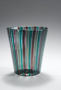 Gio Ponti. Vase  designed in 1955 Made by Venini . Clear glass, green, purple and amber coloured ribbons.