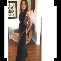 """🎉Host Pick🎉Gorgeous Black & Nude Evening Gown 🔥This Stunning full-length Gown offers a Suggestion of """"Playfulness"""" with Sheer Lines/insets running down sides of dress. Perfect for Black Tie affair or Holiday Party! It's Fully Lined with Nude color fabric. Gown is sleeveless with Scoop neckline both front & back; softly padded bra cups (see pics); center back zipper. Made of 95% Poly/5% Spandex. Hand wash/dry flat. NEW with tags! (Newly purchased for event but unable to attend).🔥This gown…"""