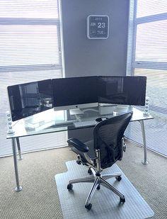 "Reader Ken Silver shares his desk.Frezza System glass desk, Aeron executive chair, iMac 27"" 5K, two 27"" Apple displays, wireless Apple keyboard, Apple Magic Mouse, Harman Kardon sound system."