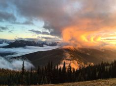 Clouds battling a sunset over Olympic National Park, WA, USA
