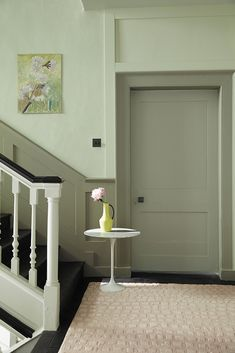 love these green paint colours for hallways - pale soft green for the upper wall and deeper grey green for dado, archetrave and doorway. Click through for more green paint colours for hallways you'll love Green Hallway Paint, Hallway Wall Colors, Grey Hallway, Hallway Ideas, Paint Colours For Hallway, Wall Paint Colors, Painting Over Paneling, Hall Painting, Sage Green Paint