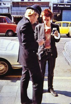 Sex Pistols: Johnny Rotten meets a copper.