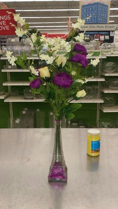 Yellow roses and pinkish  purple ranunculus in Paris vase. Cute simple and classy