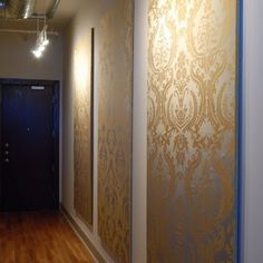 Foam panels or plywood covered in patterned fabrics, then highlighted by track lighting.