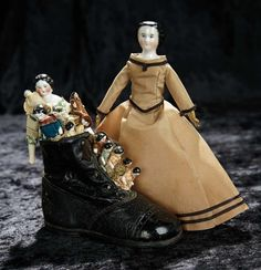 Soirée: A Marquis Cataloged Auction of Antique Dolls and Automata - May 14, 2016: Lot 219. German Porcelain Lady Doll and Old Woman Who Lived in a Shoe