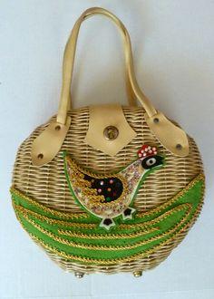 Wonderful natural wicker round purse with felt bird applique.