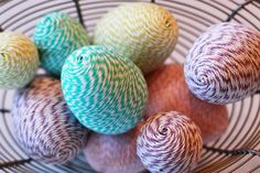 Twine Time: Wrapping plastic Easter eggs in brightly colored baker's twine gives them a rustic, homespun look.